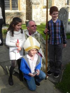 the grandchildren with the Bishop